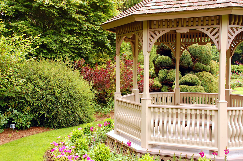 Traditional wooden gazebo in garden