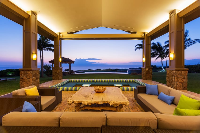 Tropical home with covered patio using faux masonry tiles with amazing ocean view