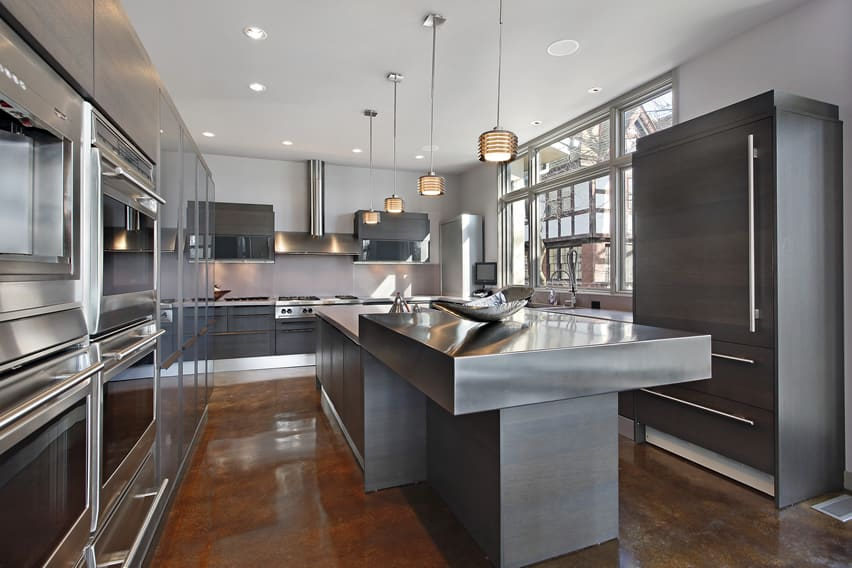 Ultra modern kitchen design with grey cabinets and stainless grey countertops