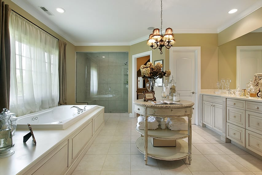 Elegant bathroom uses 30x30 marble finish ceramic tiles and features island vanity