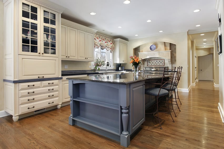 Upscale kitchen with offwhite cabinets and large granite island