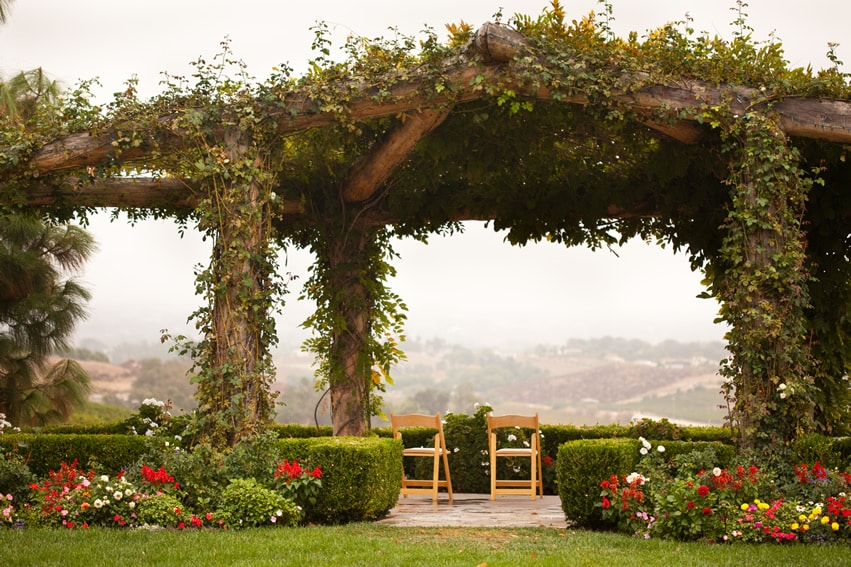 Vine gazebo in garden setting with view