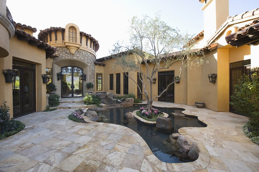 Water feature at luxury home with small island