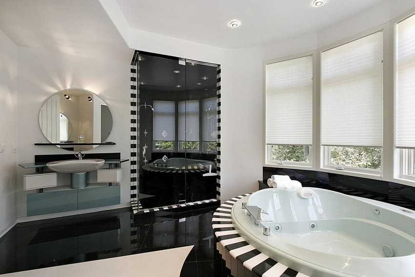 Large modern black and white bathroom with high gloss finish