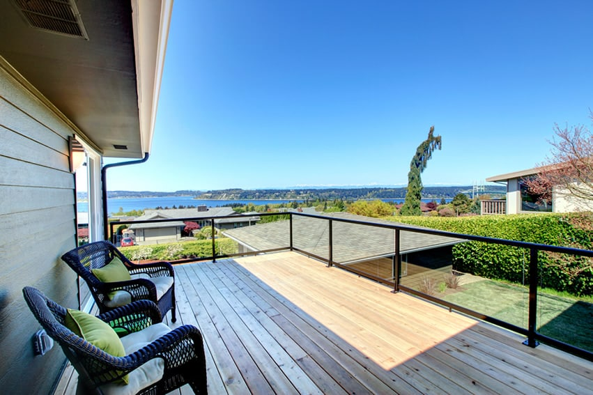 Wood deck with glass railing and bay views