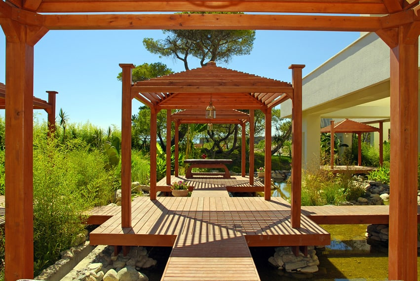 Wood deck over pond with pavilions
