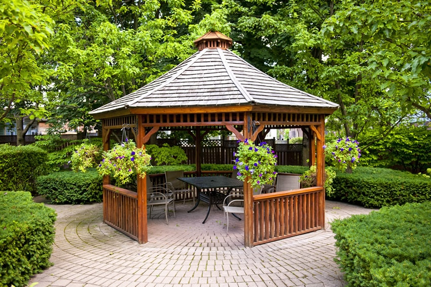 Wood garden gazebo on brick pavers