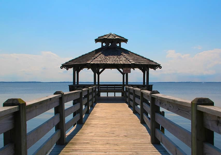 Wood gazebo at end of dock on lake