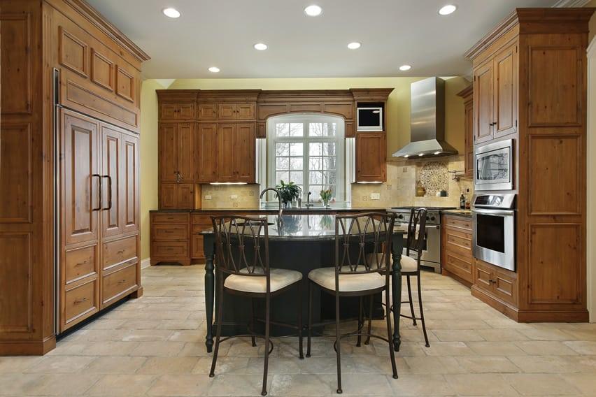Oak wood cabinet kitchen with large black center island