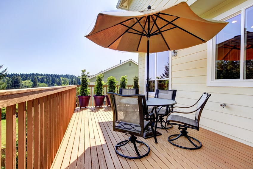 Wooden backyard deck with table and umbrella