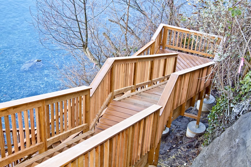 Wooden deck stairs down to lake