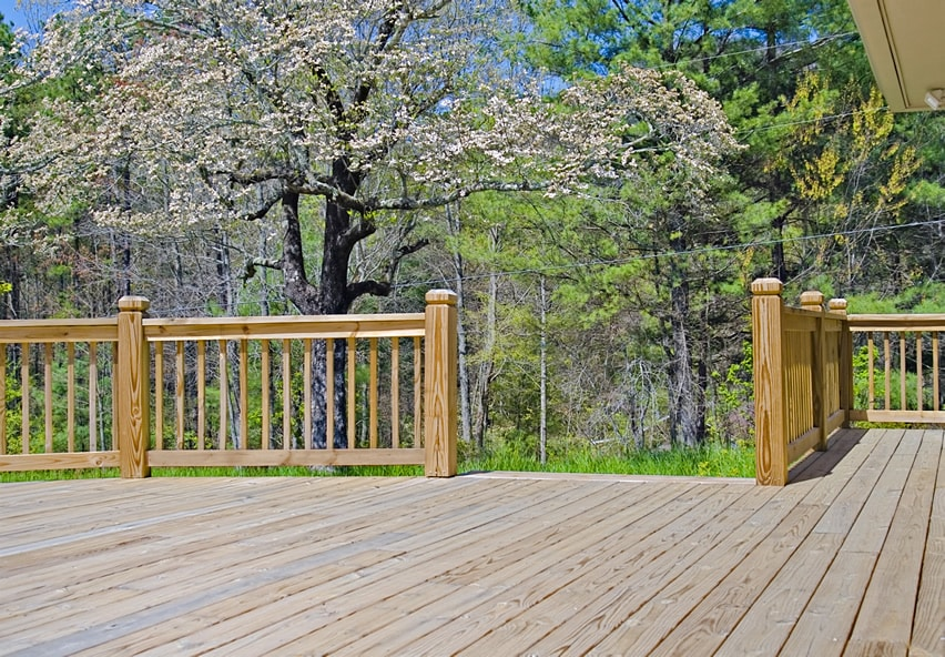 Wooden deck with wood hand rails