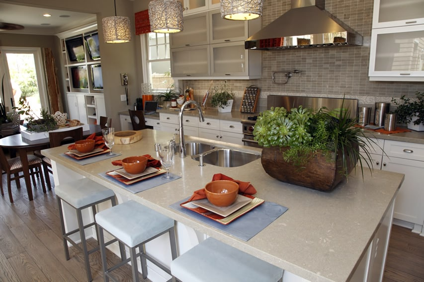 Beautiful kitchen with tile back splash quartz island