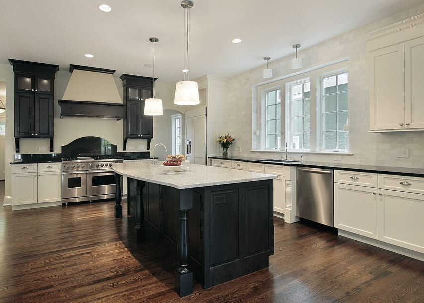 Upscale kitchen with black cabinet upper and white cabinet lower and marble counters