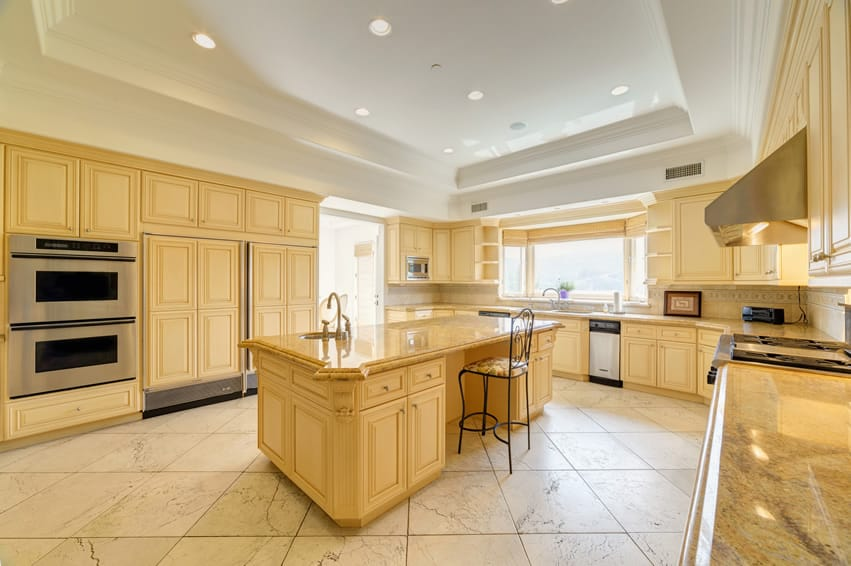 Bright large kitchen design with tray ceiling