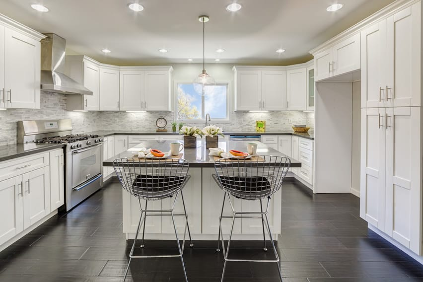 Bright white upscale kitchen with eat-in island