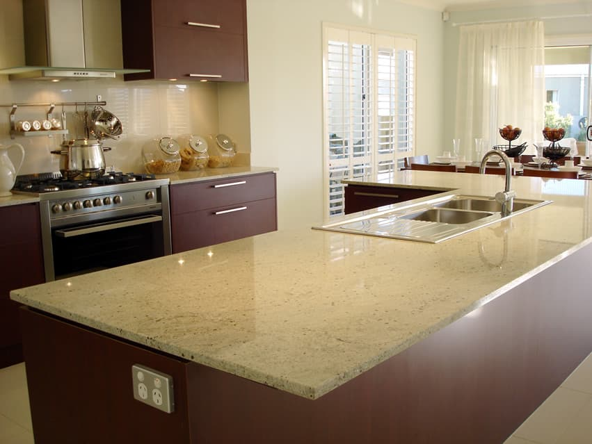 Contemporary kitchen design with dark brown cabinets, large island and light quartz countetrtops