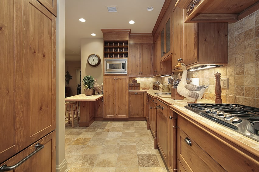 Country kitchen with walnut cabinetry and rustic decor