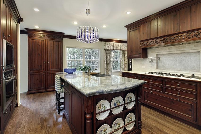 Dark wood kitchen with interesting light fixture