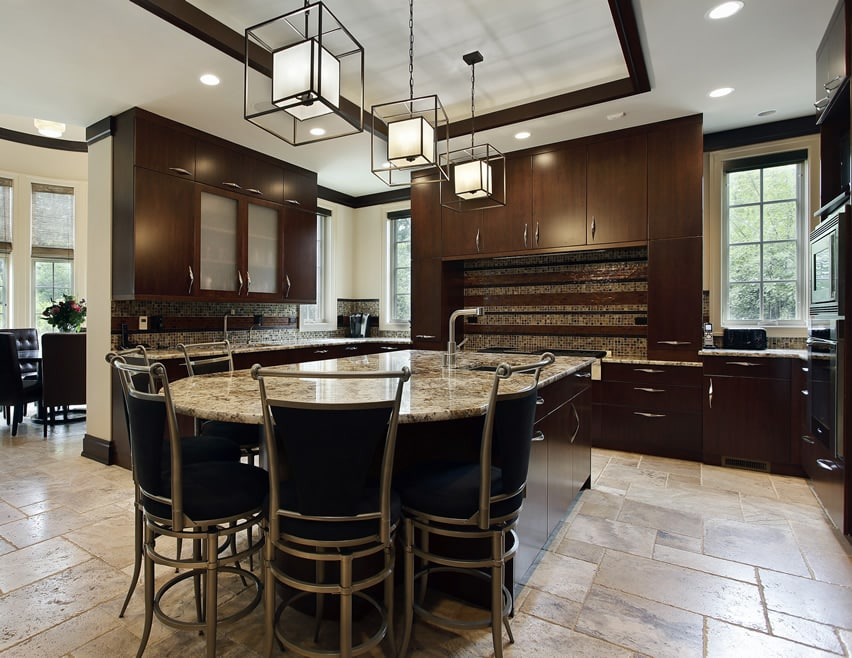 Kitchen with dark cabinetry with rounded island