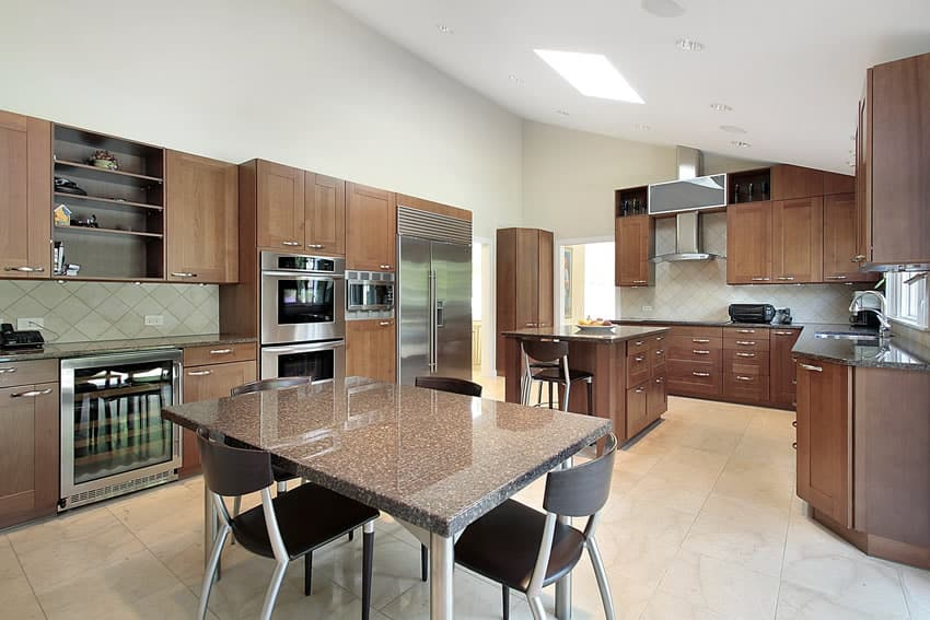 Kitchen with granite island and table in upscale home