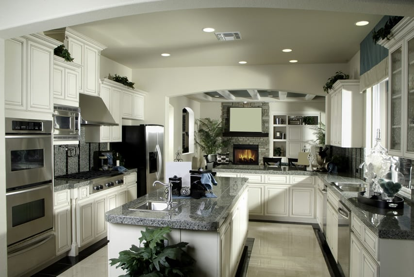 Kitchen with thick cut granite and a white theme