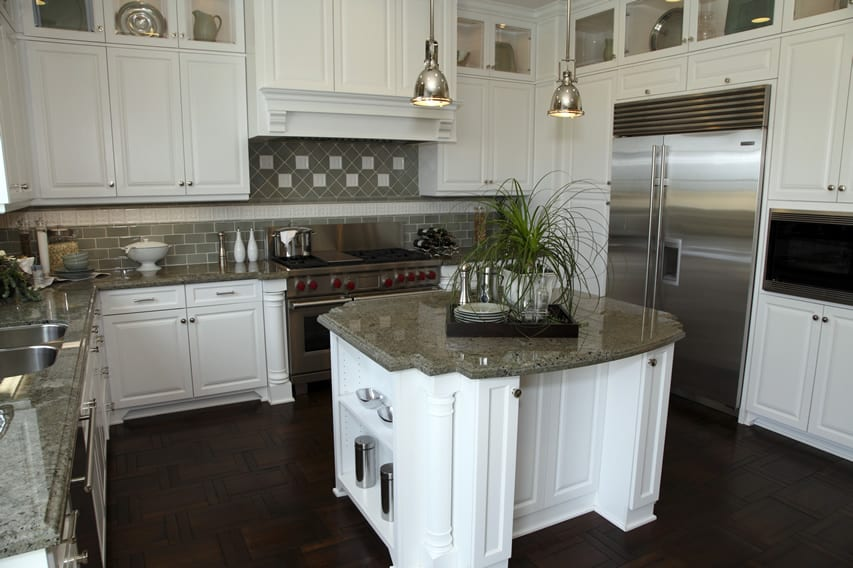 Kitchen with white cabinetry stainless fixtures