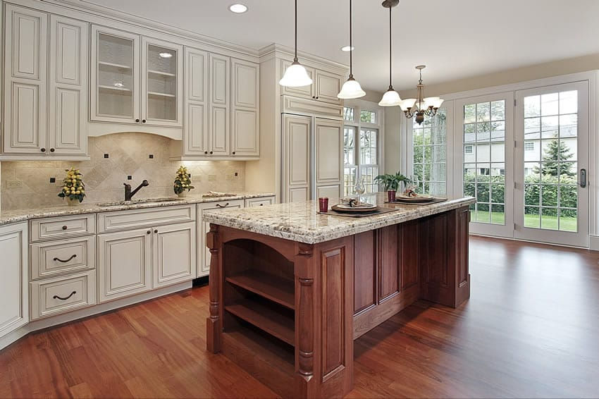 Kitchen with white cabinets wood island