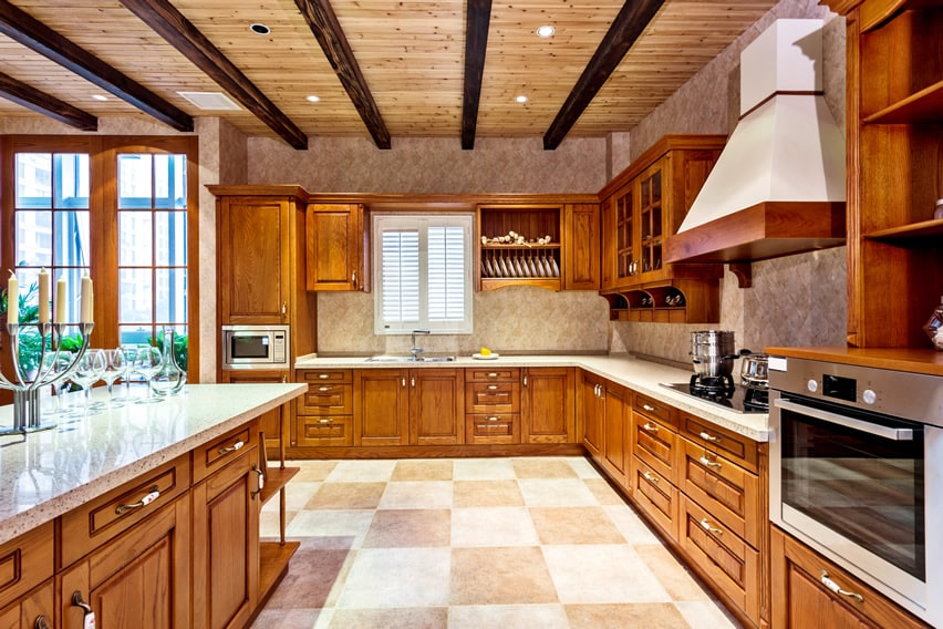 Large upscale kitchen with exposed beams