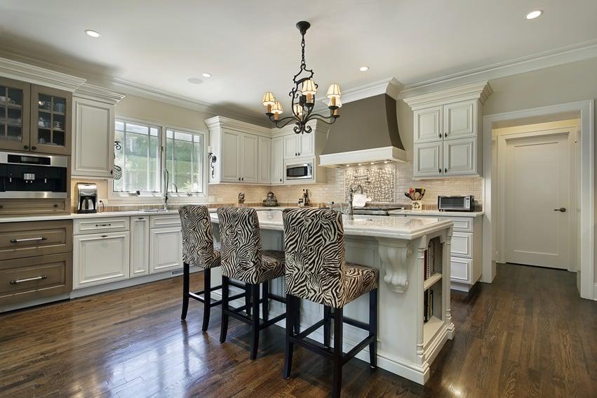 Luxury white kitchen with zebra chairs