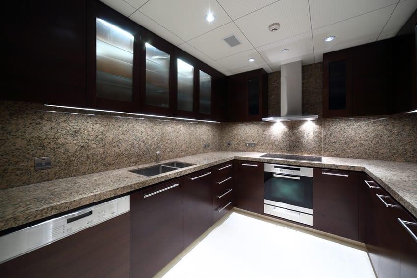 Modern kitchen design with dark cabinets