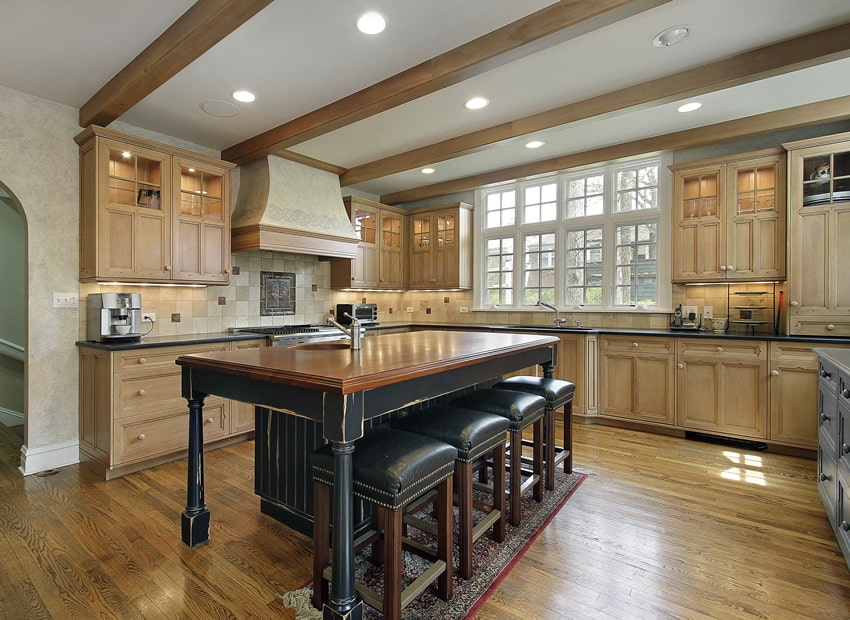 Oak kitchen in luxury home with distressed wood island
