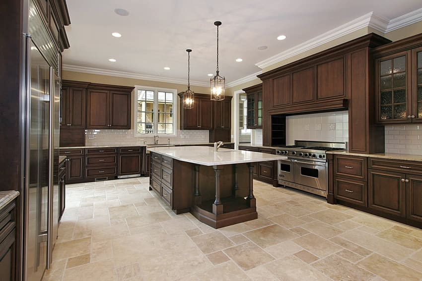 Spacious kitchen in luxury home with dark wood cabinets