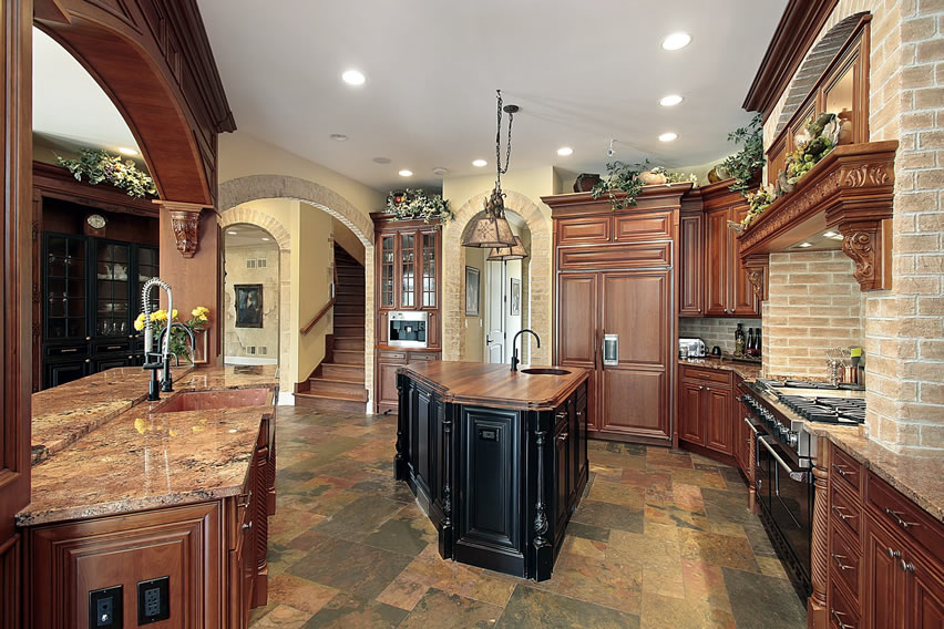 Upscale kitchen with island brick accent wall