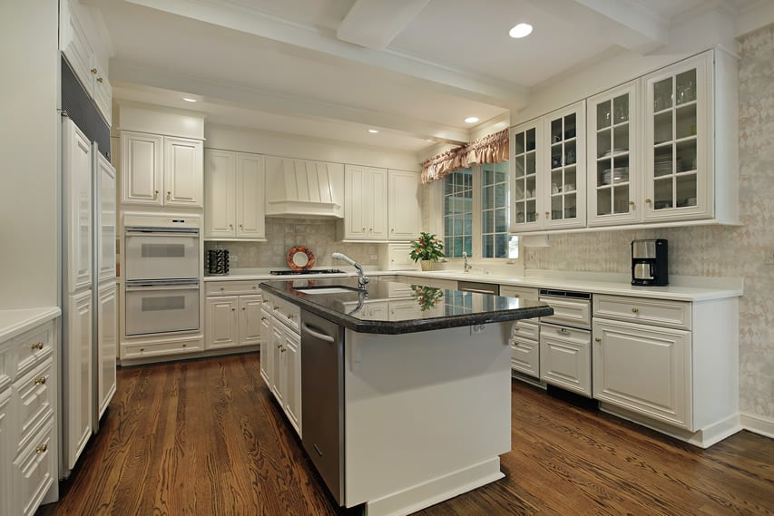 White cabinets with glass face in kitchen