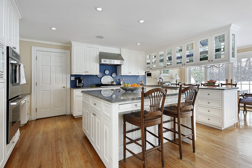 White classic kitchen design with glass faced cabinets