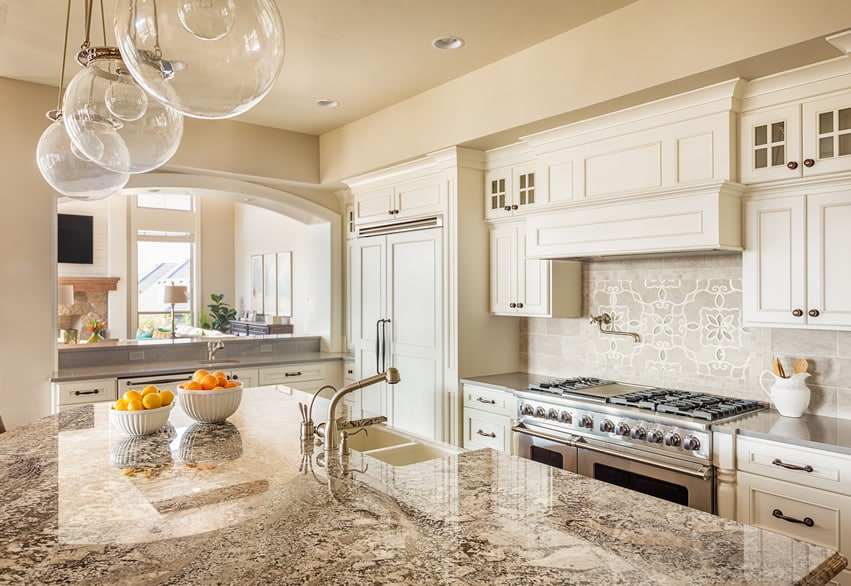 White luxury kitchen with light beige granite counter tops
