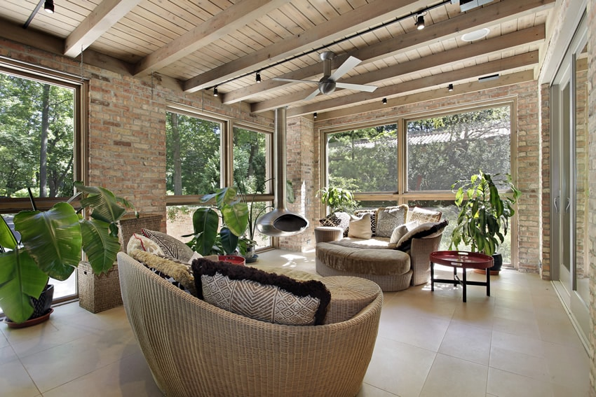 Brick sunroom with wicker furniture