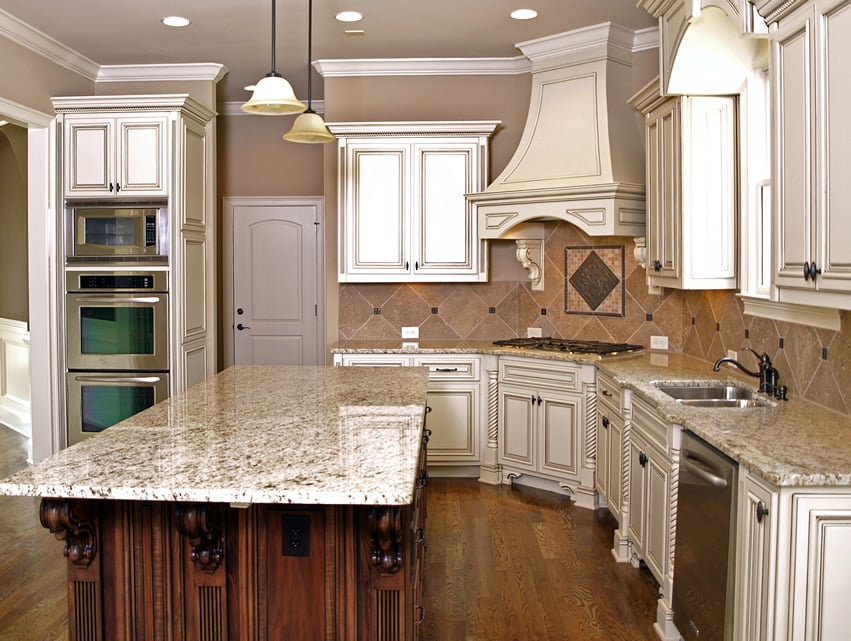 Carved wood kitchen island with light granite counter