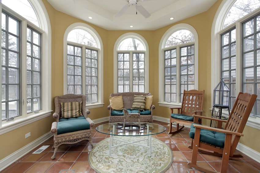 Circular shaped sunroom in yellow with tile floor