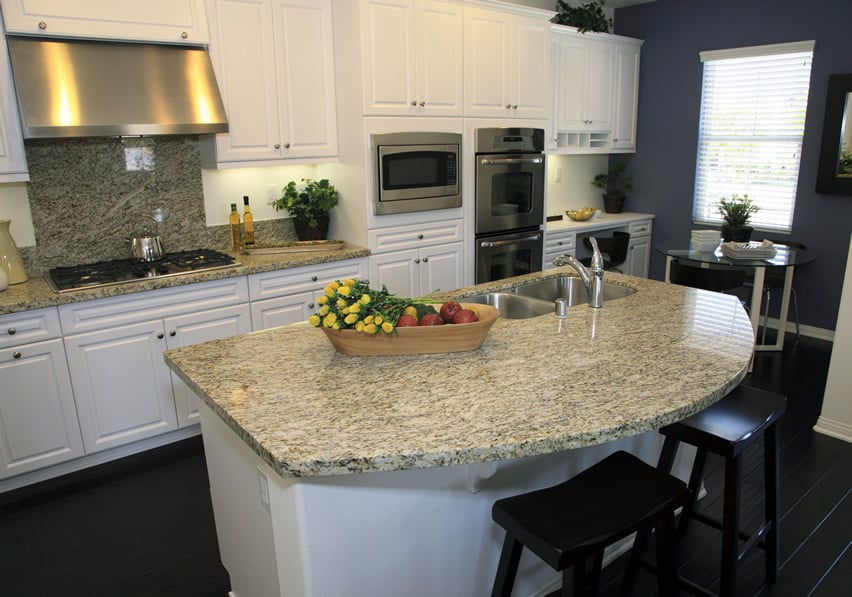 Curved granite kitchen island with undercounter sink