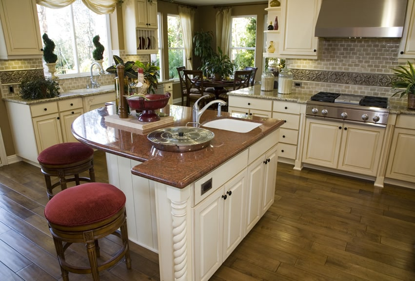 Custom kitchen island with red granite