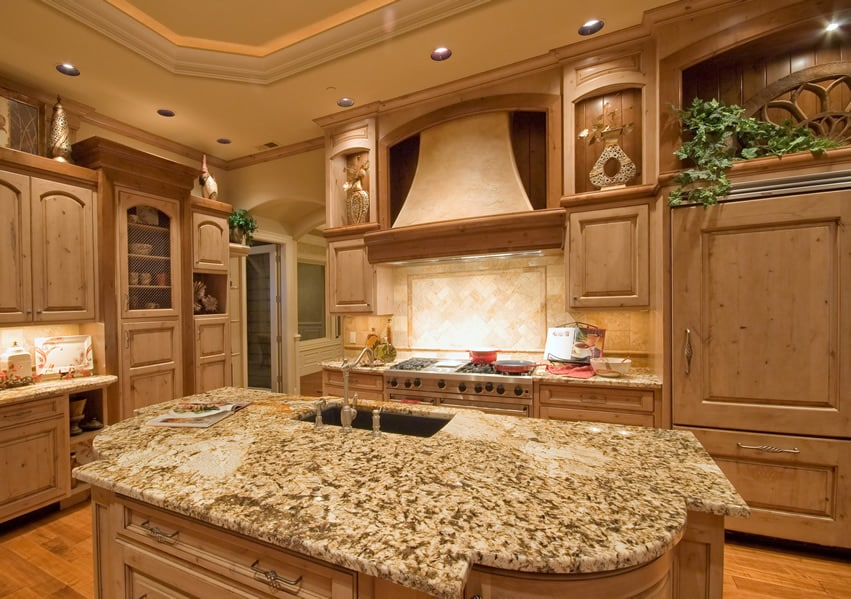 Custom wood kitchen island with granite counter