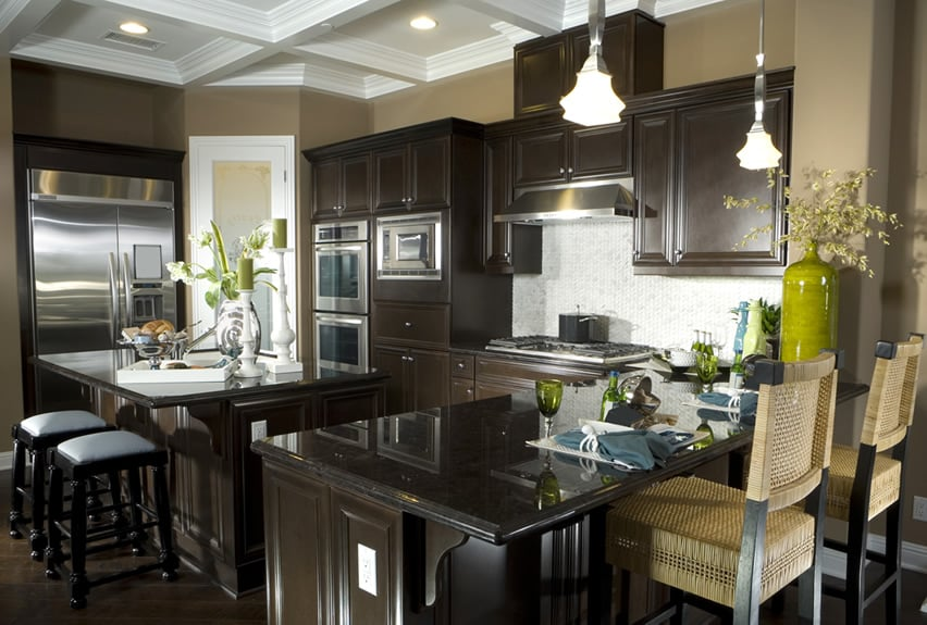 Dark kitchen island with eat in dining and bar counter