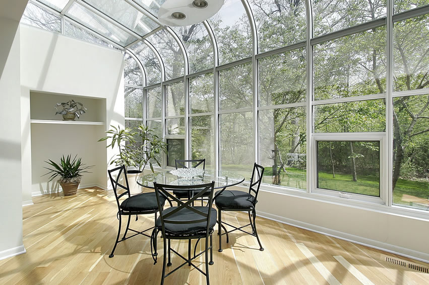 Glass sun room with nature view