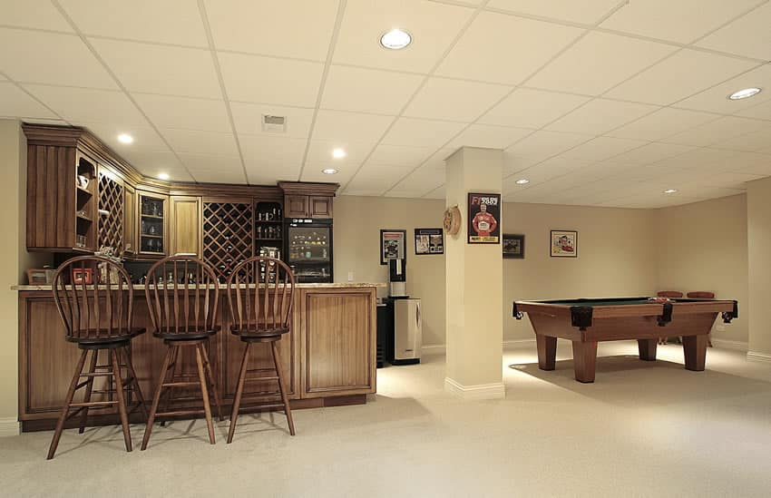 Home bar in basement with pool table