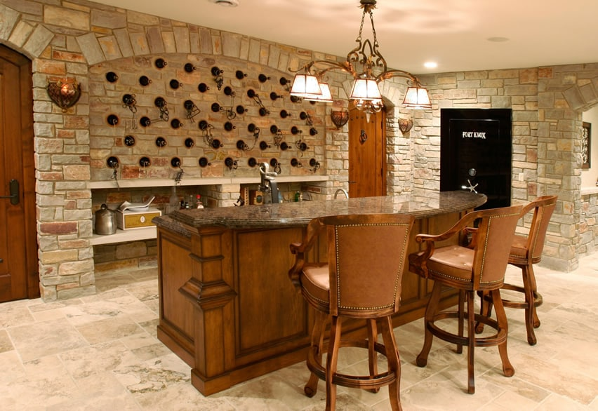 Home bar in basement with stone wine storage