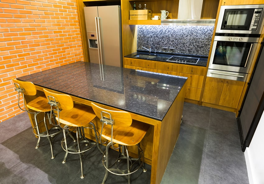 Kitchen island with light wood matching bar stools