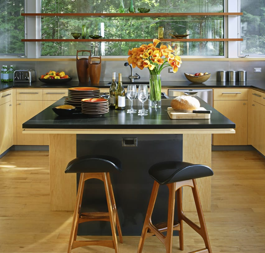 Large square kitchen island with black counter