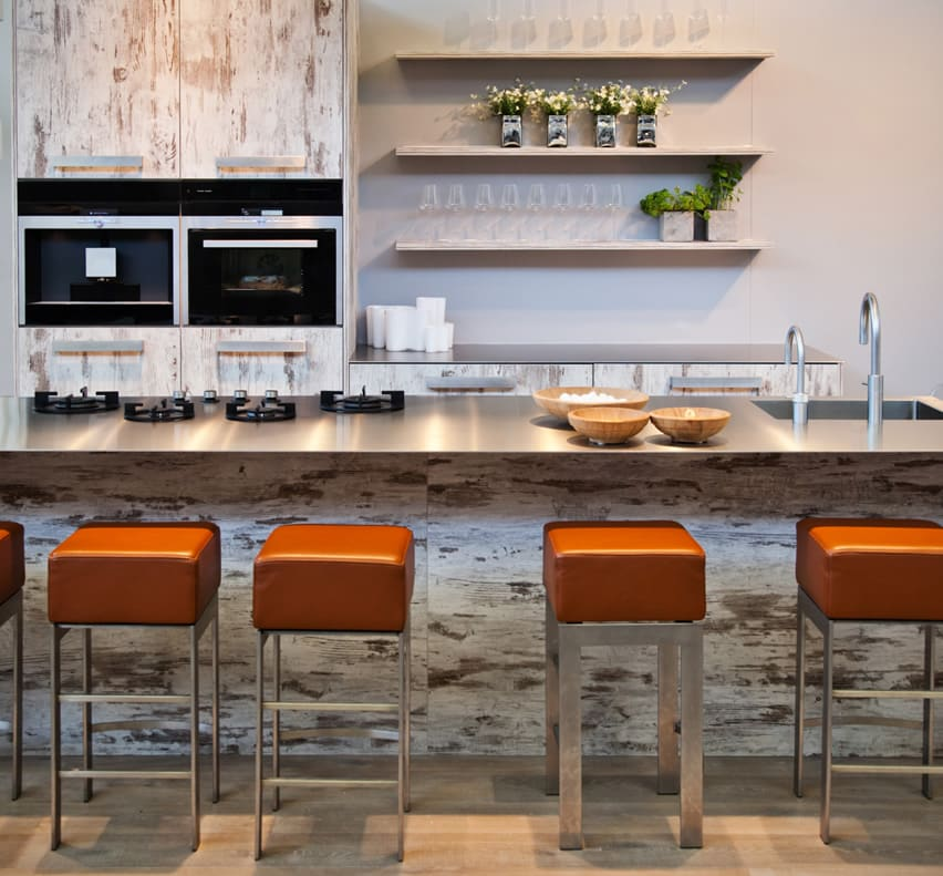 Long modern kitchen island with orange barstools